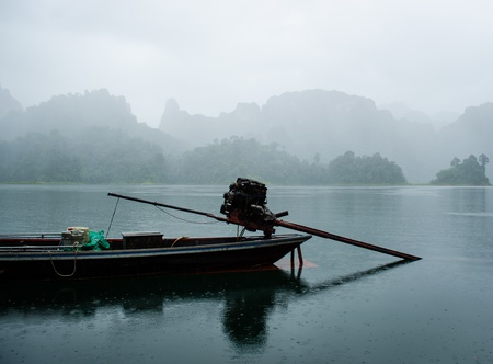 lake view with mountian in the fog during rainy in thailand photo