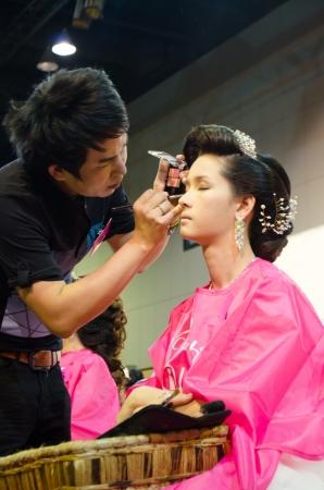 BANGKOK THAILAND-DEC  makeup artist and  model during bride makeup competition in thailand open hair chapionship december 19,2012 at bangkok thailand