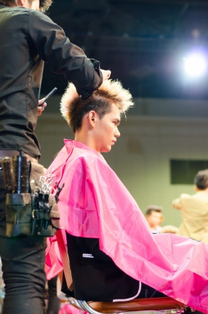 BANGKOK THAILAND -DEC hairdresser and  hair model during competition in thailand open hair championship, december 19, 2012