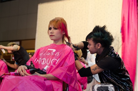 BANGKOK THAILAND -DEC a hairdresser and a hair model during competition in thailand open hair championship, december 19, 2012 Stock Photo - 17024930