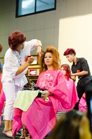 BANGKOK THAILAND -DEC a hairdresser and a hair model during competition in thailand open hair championship, december 19, 2012