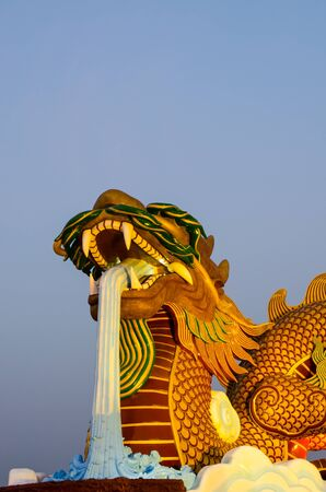 giant gold  dragon with blue sky photo