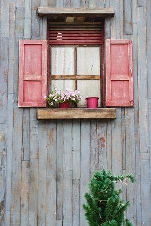 red vintage window on wooden wall photo