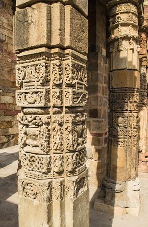 minar: ancient stone pole in qutub minar, india