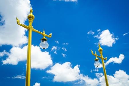 golden lamp against blue sky photo