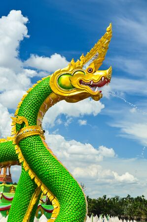 green king of serpent against blue sky photo