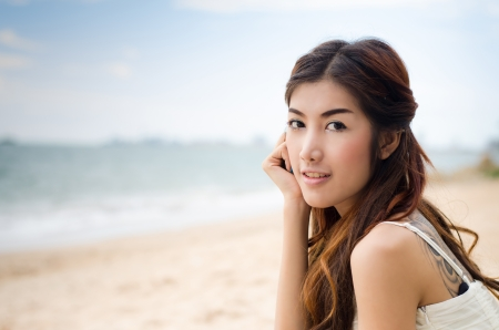 happy beautiful lady on the beach Stock Photo