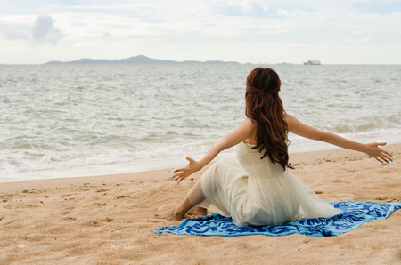 asian lady chilling on the beach