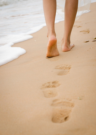ladys leg walking on the beach Stock Photo