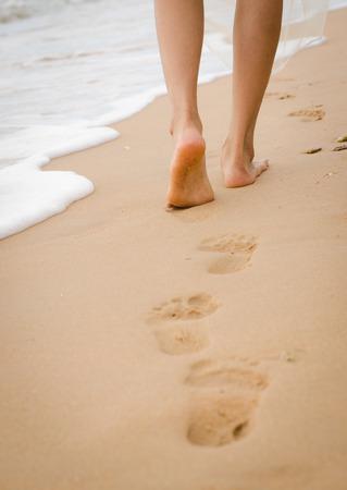 ladys leg walking on the beach Stock Photo