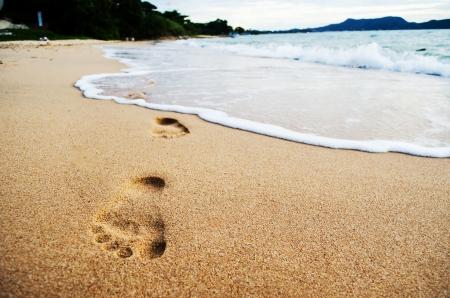foot step: passo piede sulla spiaggia Archivio Fotografico