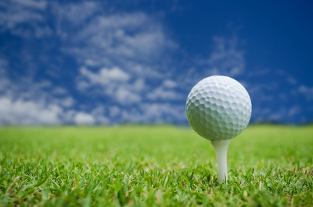 close up of a golf ball against blue sky photo