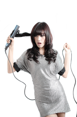 straightener: woman joyful with her hair straightener