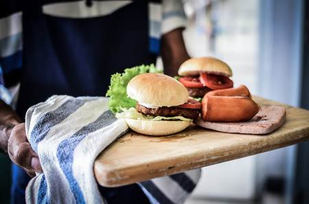 fast service: burgers and sausage ready for serve Stock Photo
