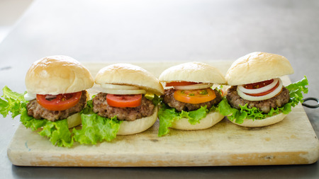 serve: burgers and sausage ready for serve Stock Photo
