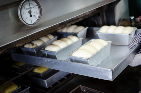 putting in: raw bread during putting in a oven at about 150 degree