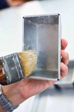 daub: preparing baking mold by daub the shortening onto it