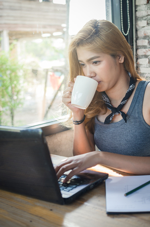 beautiful girl working in cafe with laptop