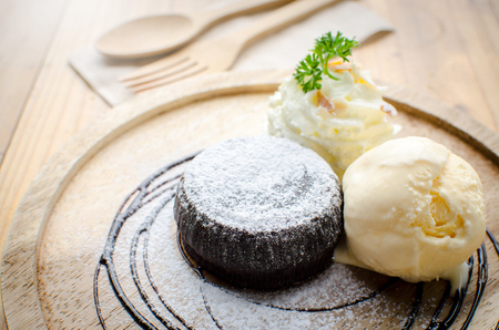 chocolate lava serve with whipping cream and ice cream Stock Photo
