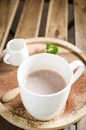 hot chocolate serve with syrup and decorated with coacoa powder Stock Photo