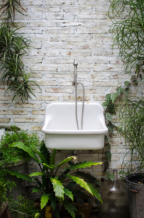 white sink in the forest bathroom
