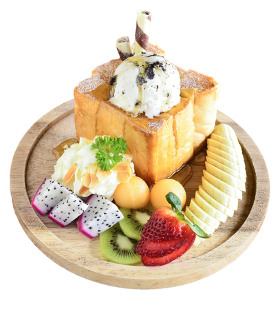 honey toast server with ice cream and mixed fruits in thai cafe