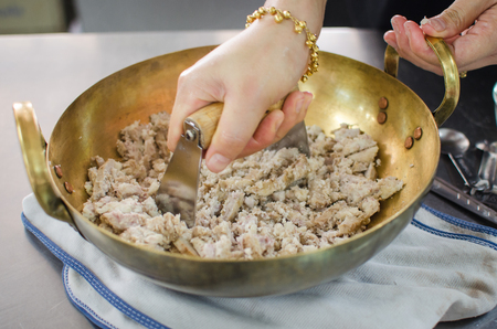 woman crushing taro for make thai dessert Stock Photo