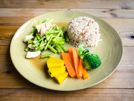 brown rice with fried  asparagus with pork and steamed vegetable
