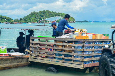 KRABI, THAILAND, NOV 6 : cargo in the boat from land being transport into a truck on islad on November 2, 2016 at Railay beach, Krabi, Thailand