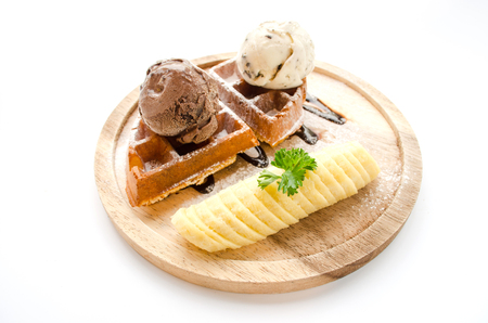 solt waffle serve with banan and ice cream isoalted on white background Stock Photo
