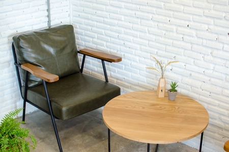 military green leather armchair in the cafe