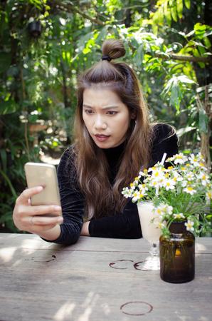 thai girl using smart phone in garden