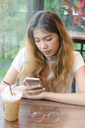 girl using tablet on wooden table