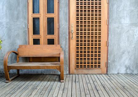 loft outdoor sofa in front of wooden window