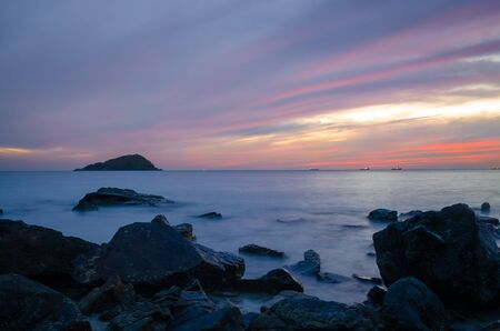 sunset at coast line in thailand, shoit with slow shutter speed