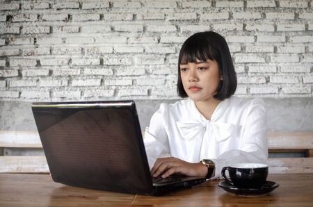 young woman using laptop in cafe Stock Photo