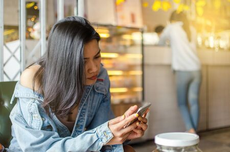 girl using smart phone in cafe Stock Photo