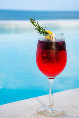 iced mixed berry cocktail against pool side Stock Photo - 126175899