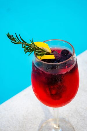 iced mixed berry cocktail against pool side Stock Photo - 126175914