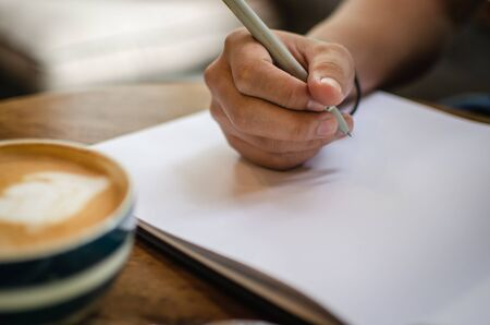 man using notebook in cafe Stock Photo - 126179311