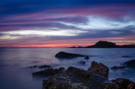sunset at coast line in thailand, shoit with slow shutter speed Stock Photo - 126179336
