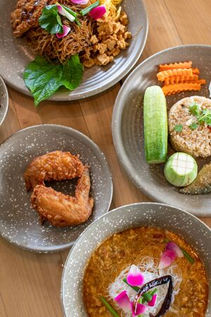 northern thai food on wooden table