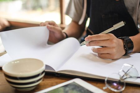 man using notebook in cafe Stock Photo