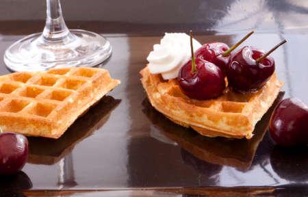 Cherries Tart Slices with fresh vanilla cream on dish photo