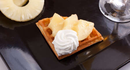 Pineapple Tart Slices with fresh vanilla cream on white dish photo