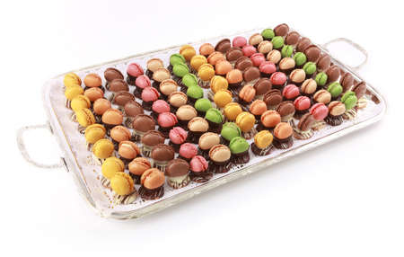Colorful variety macaroons tray on white photo