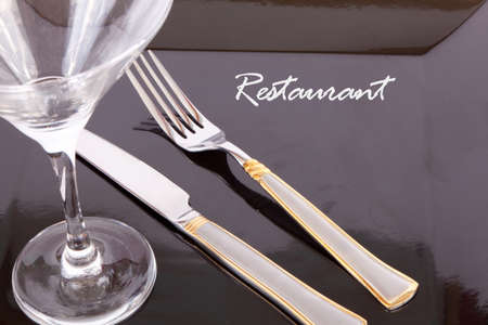 Restaurant Design black Dish with fork and knife, your text here  photo