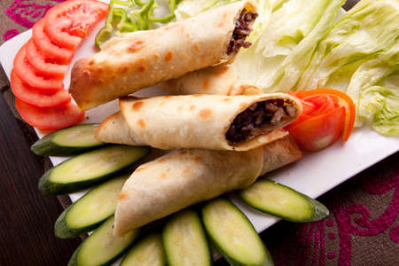 Eastern traditional meat shawarma plate with tomatos. photo