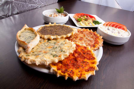 Oriental pizza plate of traditional Arabic food manaqish.
