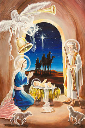 Christmas Manger scene with figurines including Jesus, Mary, Joseph, sheep and magi. photo